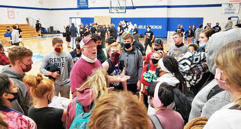 Coach Kevin Childers talks with his powerlifters on Saturday during the powerlifting meet in Bosqueville. Contributed Photo by FHS News