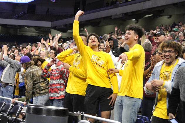 Members of the Eagles basketball squad react to Clark's overtime heroics.