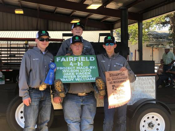River Bonds, Brady Williams, Jake Hughes and Wilson Lupo were awarded first place in Senior Showmanship at the Ag Mechanics Show. Photo contributed by Kayla Lupo.