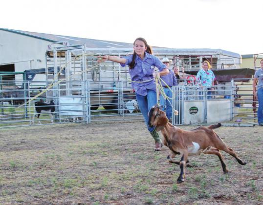 Emery Black, of Dew, practices goat-roping during her time at Texas Ranch Brigade, a camp in Santa Anna, offering hands-on experience in ranching and wildlife activities. Contributed Photo