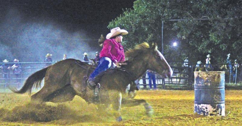 Rheagan Cotton of Fairfield whips around a barrel during the Youth Rodeo in memory of Yates Manahan. Photo by Mitchell Pate