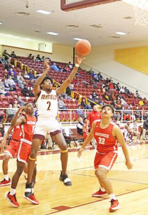 Junior DaKerione Cunningham puts of a basket for the Eagles on Friday night against Groesbeck. Photo by Mitchell Pate